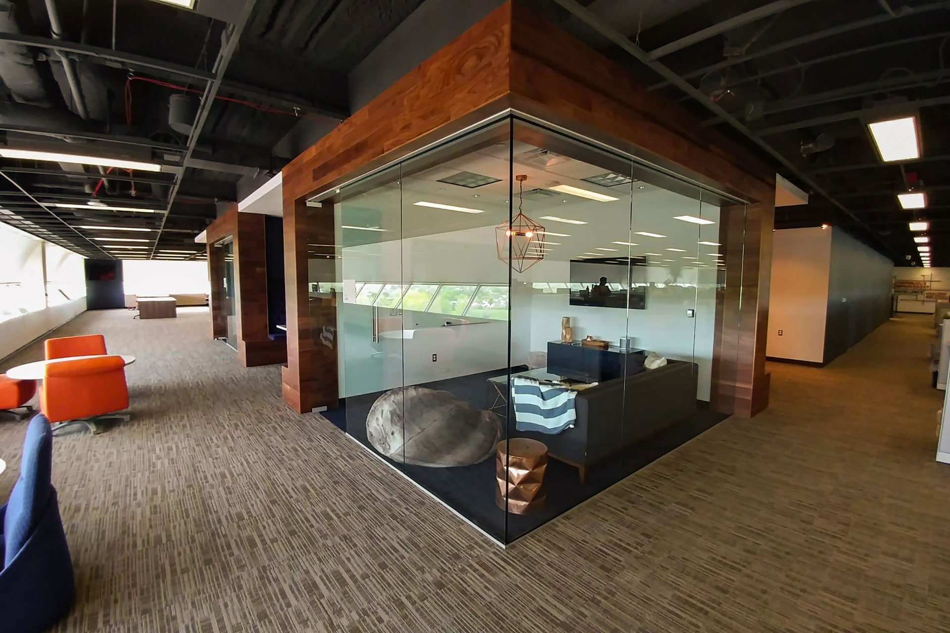 Stained and finished walnut wall panels for a corporate office. Created for privacy in an open floor plan office space.