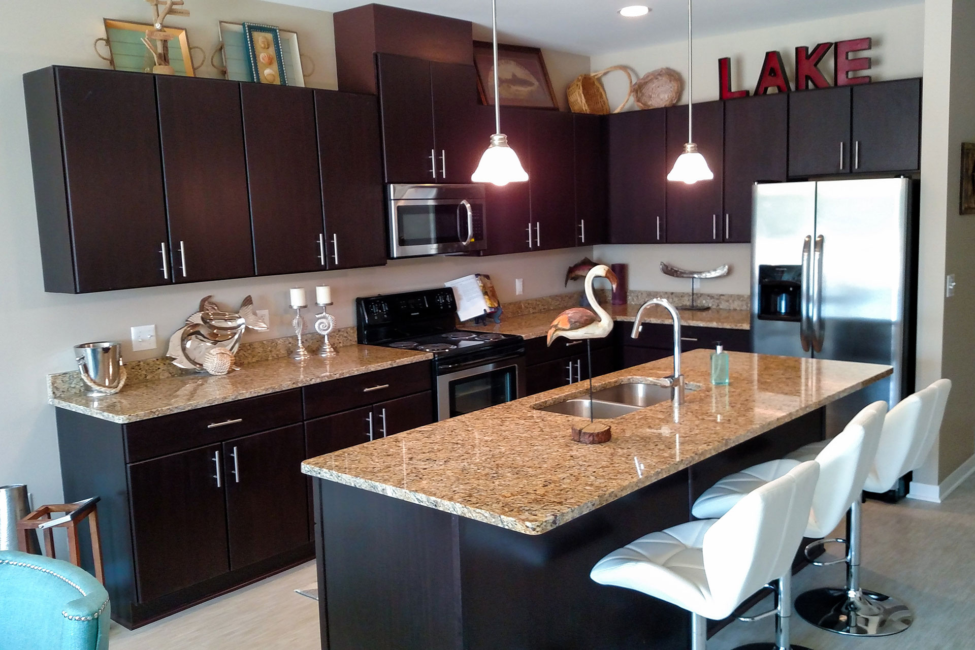 Pre-fabricated cabinets and granite countertops. Fabrication and installation of wood base, casings and doors.