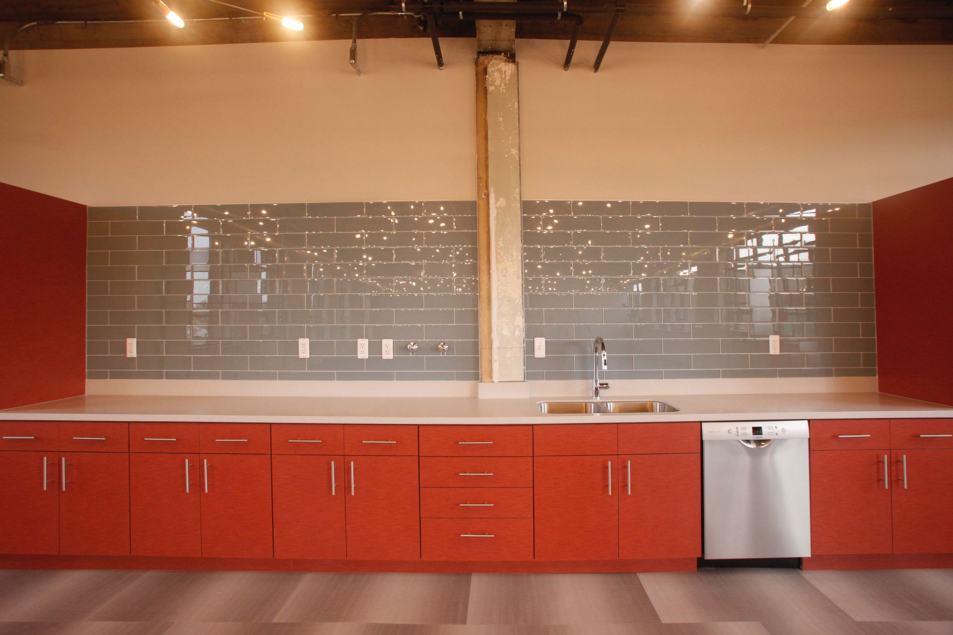Plastic laminate cabinets, with solid surface countertops.