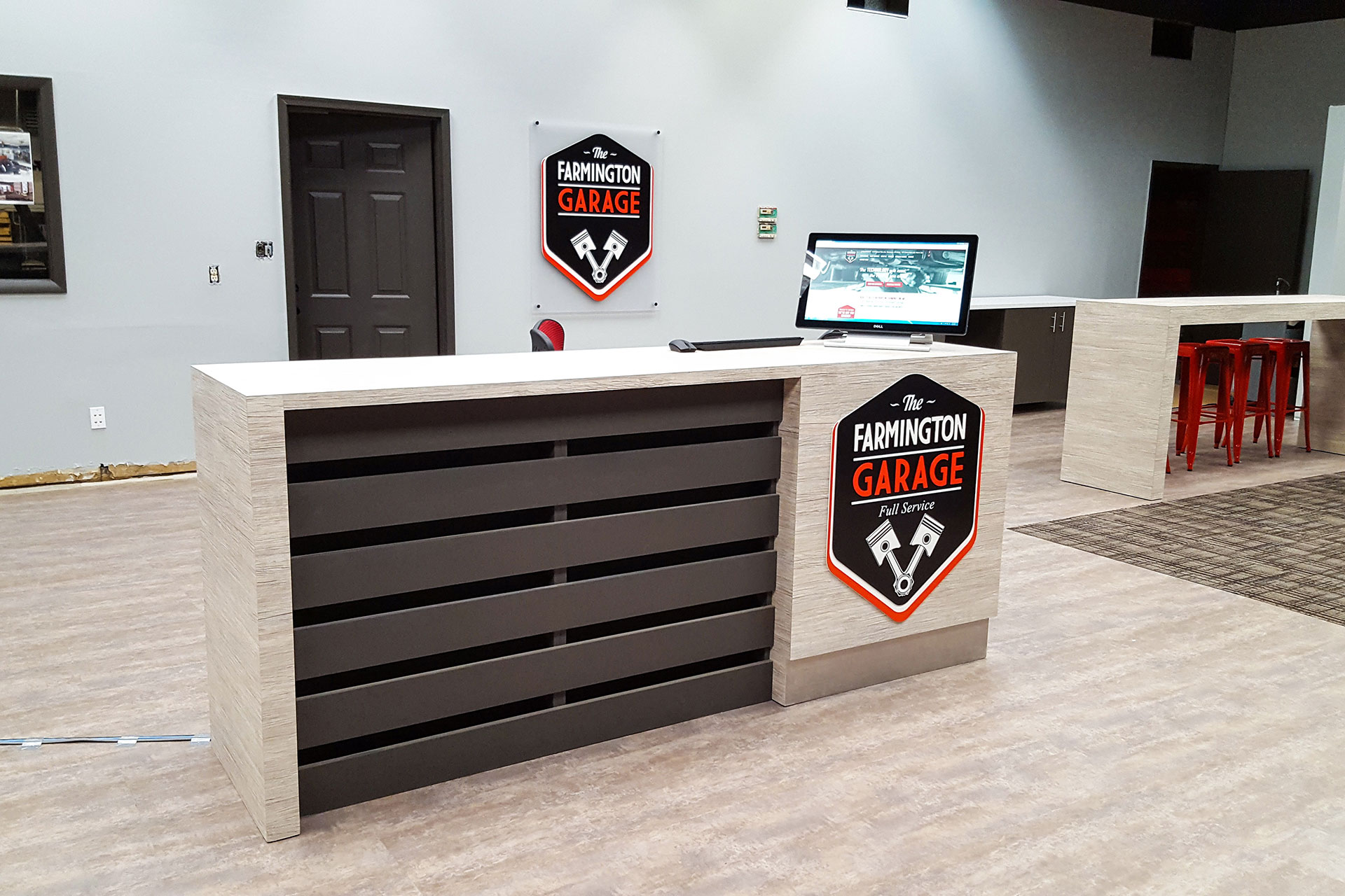 Custom plastic laminate reception desk with recessed painted wood slats.
