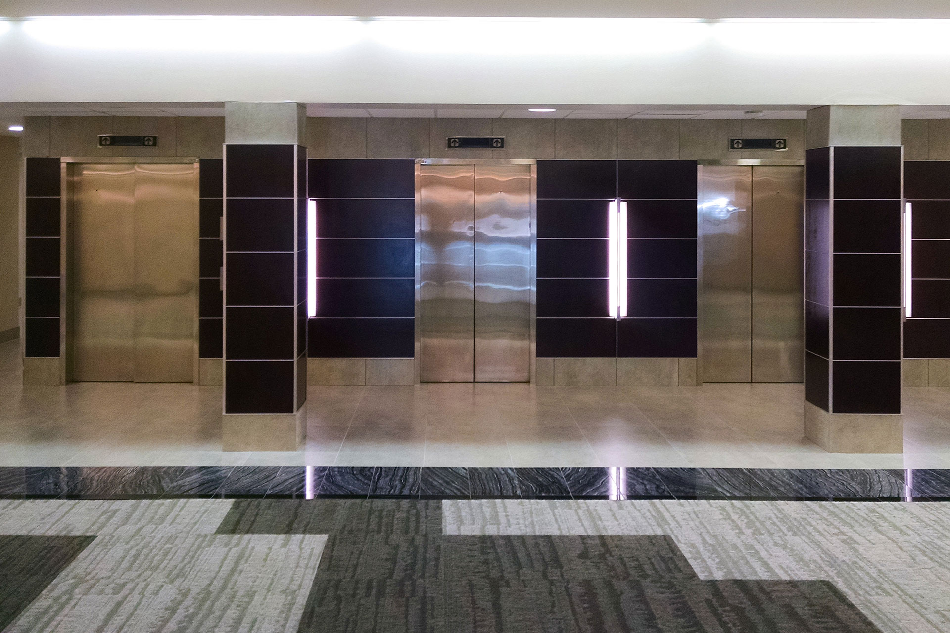 Stained and finished mahogany panels with brushed stainless steel accent trim.
