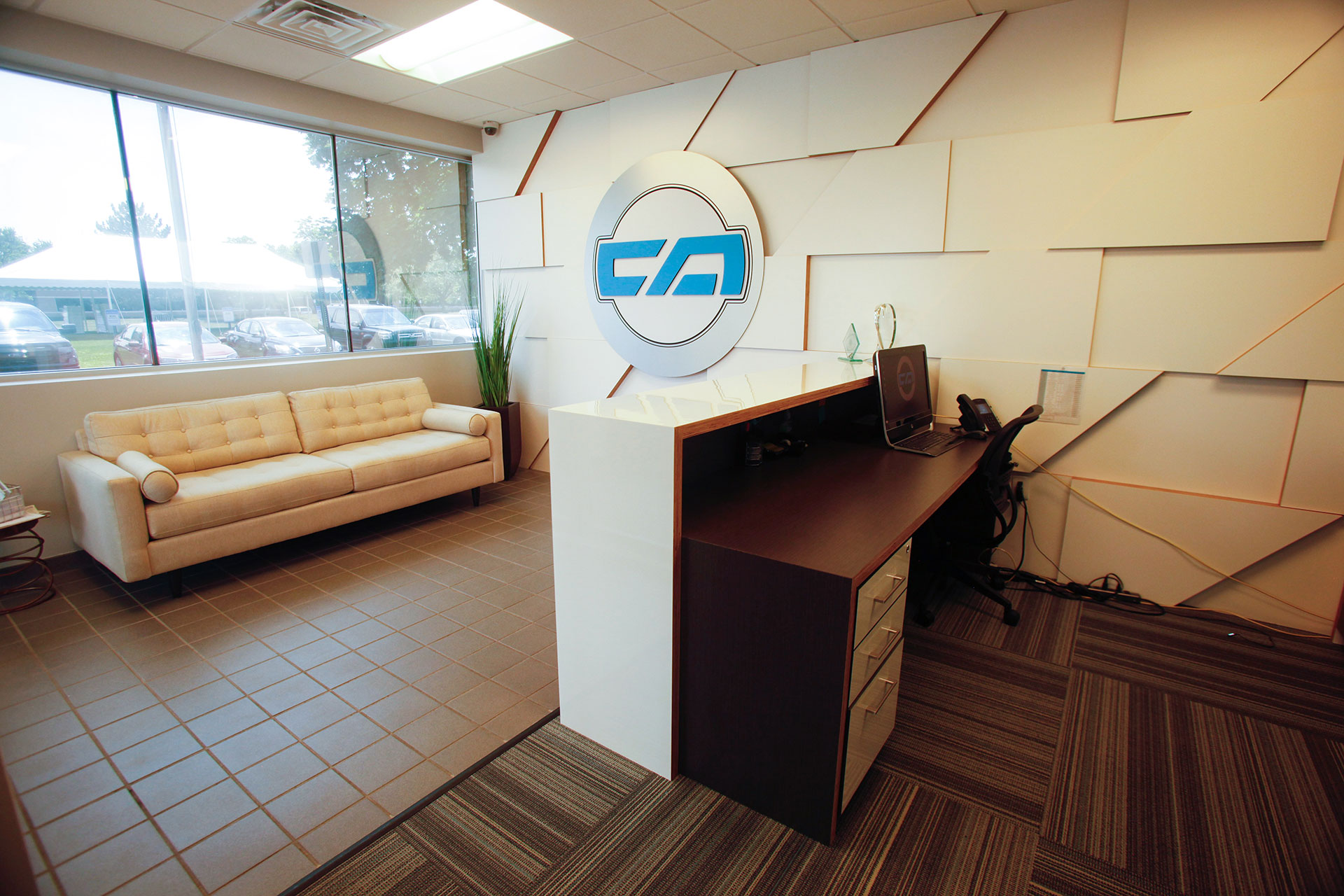 Custom plywood/plastic laminate wall panels and reception desk with matching transaction top surround.