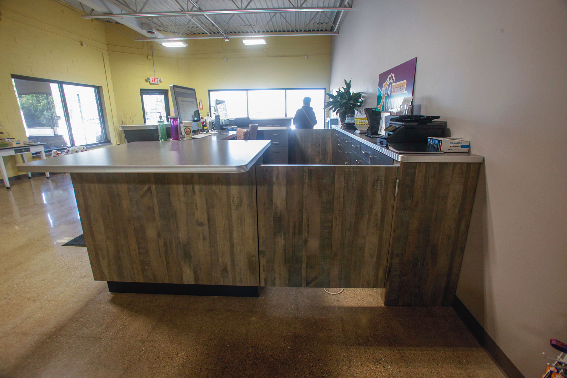 Custom check in and check out reception desk with plastic laminate countertops.